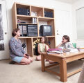 Students gather in the living room of their University Oaks on-campus apartment