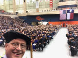 Selfie of President Taylor Eighmy and students at Convocation