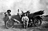 Newt Chaney and Adolph Houseton with coyotes killed on the Adolph Houseton Ranch near Simmons,...