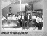 Bank president M. B. Loyd and employees in the First National Bank of Fort Worth