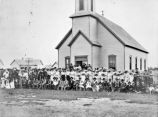 Odd Fellows Lodge members and their families outside Methodist Episcopal Church, El Campo, Texas,...