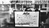 Relocation notice in window of Mike the Expert Hatter, 702 Dolorosa Street, San Antonio, Texas