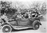 People in automobile decorated for parade, Del Rio, Texas, late 1910s