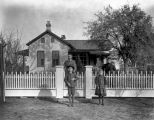 Joseph V. Koch family and Oliver Reinhart outside residence, D'Hanis, Texas