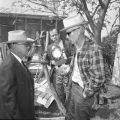 Sheriff Bill Hauck (L) talks to Frank Toudouze in the backyard of the Toudouze home, 123 Wyoming Street, after Hauck...