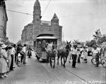 Ed Rivas with mule-drawn streetcar at Main Plaza with Bexar County Courthouse in the background.