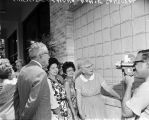 Mayor Walter W. McAllister admires Wall of Hands on Woman's Pavilion at HemisFair '68, created by (L-R) Lucille...
