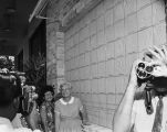 Following dedication of the Wall of Hands at entrance to Woman's Pavilion at HemisFair '68, a cameraman films Ethel...