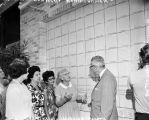Following dedication of the Wall of Hands at entrance to Woman's Pavilion at HemisFair '68, Mayor Walter W. McAllister...
