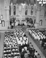 Bird's-eye view from choir loft of Most Rev. Denis E. Hurley, O.M.I., Archbishop of Durban, South Africa, saying Mass...