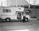 Couple, who traveled to HemisFair in their Ford F350 Huntsman Camper, pose outside the Ford Motor Company Pavilion at...